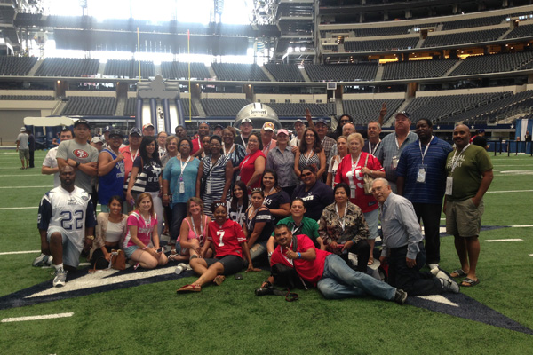 49ers fans at AT&T Stadium for a Dallas Cowboys game.