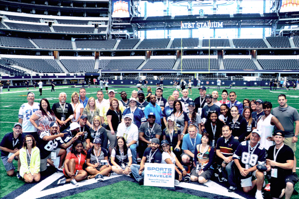 Fans on the field at AT&T Stadium during a Sports Traveler weekend package.