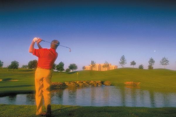 Golfer teeing off at the TPC Las Colinas Texas Resort